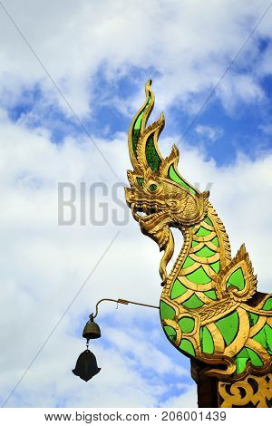Statue serpent On the roof at temple thailand