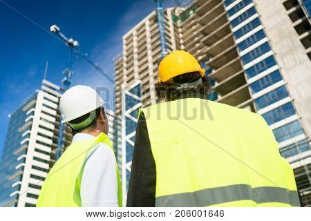 Architects or civil engineers visiting construction site