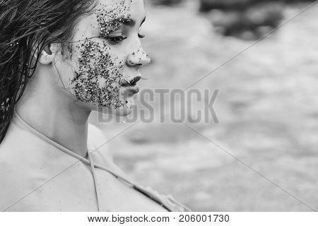 Pretty Girl With Face Dirty With Sand