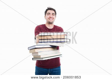 Handsome Student Offering Pile Of Books
