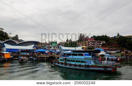 MEDAN, INDONESIA - SEPTEMBER 16,2017 : The vibrancy of market on the Toba Lake harbor, Medan, Indonesia
