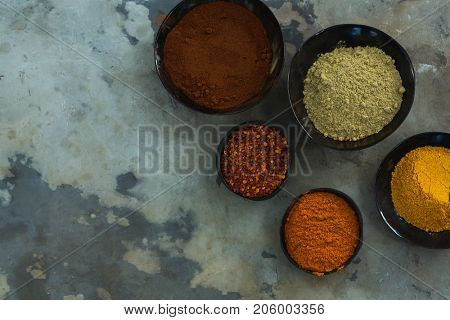 Overhead of various spices powder in bowl