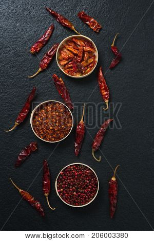 Overhead of dried red chili pepper and crushed red pepper in bowl