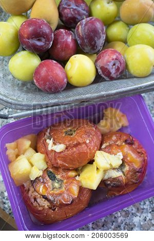 tomatoes stuffed with rice near the fresh fruit