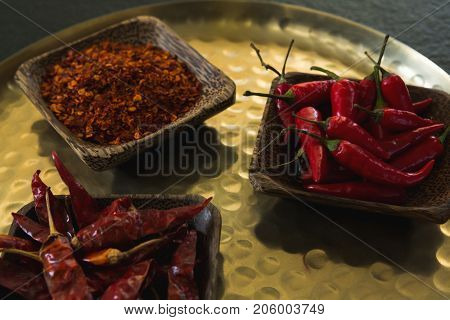 Close-up of red chilies, dried red chili pepper and crushed red pepper in plate