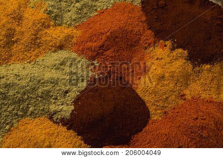 Close-up of spices powder arranged