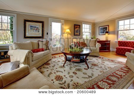 Large Cozy Living Room With Red And Beige Chairs