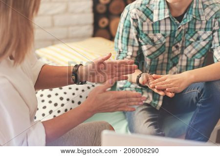 Lets discuss it. Close up of a professional female psychologist talking with a school boy and having a psychological session
