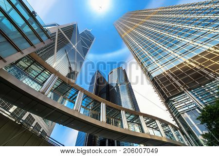 Modern business building glass of skyscrapers with sun carona and airplane central Hong Kong Business concept of architecture