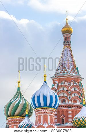 Close up of colorful roofs Church of Saint Basil Cathedral the most famous place in Moscow on Red square, Focus of top of Vasily the Blessed with blue dome of Chapel of St. Cyprian with green dome of Chapel of Three Patriarchs and top of Chapel of Interce