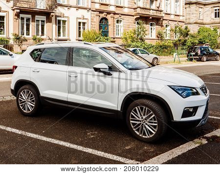 PARIS FRANCE - MAY 3 2017: Seat Ateca white SUV sport utility vehicle parked in French city urban parking