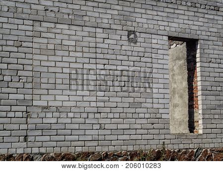 White brick wall. New brick wall with a doorway. Doorway. White brickwork. White wall. White brick background.