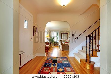 Hallway With Large Staircase And Dinign Room