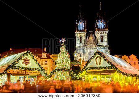 PRAGUE CZECH REPUBLIC - 18 DECEMBER 2016: Christmas Market in Stare Mesto old square Tyn Church Bohemia.