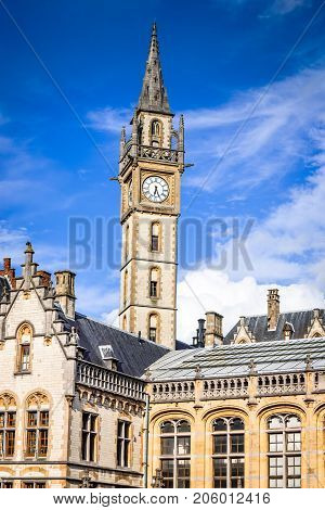 Gent city Belgium with Graslei district and Guildenhuis tower day sunlight with white clouds in Flanders
