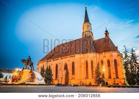 Cluj Romania. Night scene with St. Michael's Church and Unirii Square in Cluj-Napoca Transylvania.