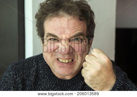 Aggressive adult man close-up portrait