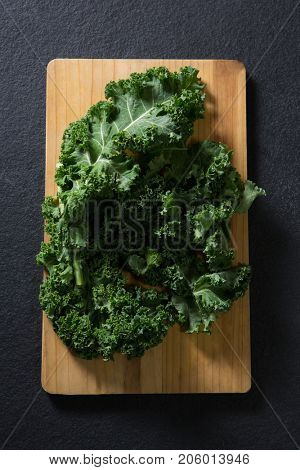 Overhead of mustard greens on chopping board