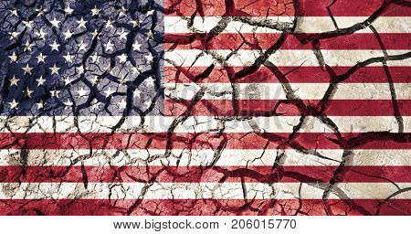 policy, crisis and collapse concept - american flag on cracked ground background