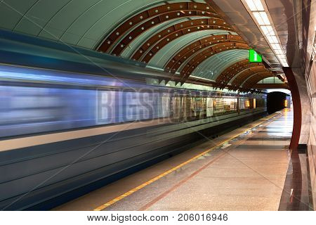 Subway station Obvodny Kanal in Saint Petersburg, Russia. Diagonal blue motion blur metro train background. Train departure. Fast underground subway train while hurtling fast with commuters on board
