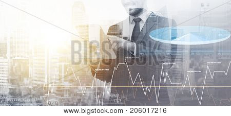 business, technology and marketing concept - businessman with tablet pc computer over city background and charts and double exposure effect