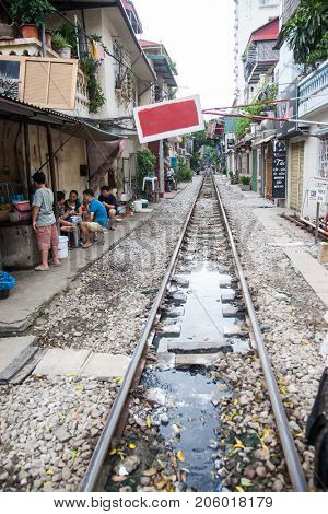 HANOI VIETNAM - AUGUST 2017: Life of people who live near the railway in Hanoi ancient town.