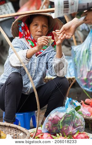 HANOI, VIETNAM - AUGUST 2017:  Street vendors selling their goods in Hanoi, Vietnam