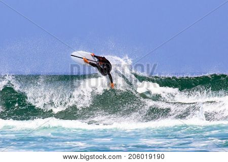 Surfer surfing the waves in Hawaii