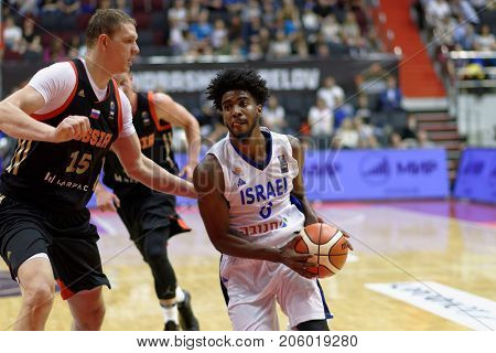 ST. PETERSBURG, RUSSIA - AUGUST 6, 2017: Shawn Dawson, Israel and Timofey Mozgov, Russia in action during basketball match Russia (black) vs Israel (white) for Kondrashin-Belov Cup. Israel won 79-71