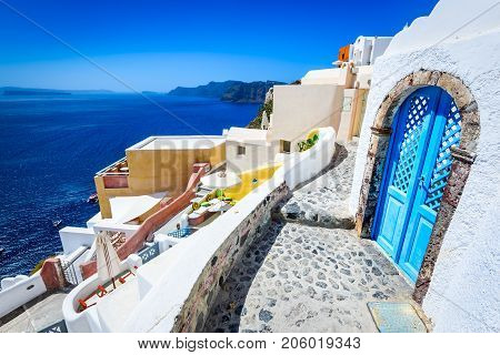 Santorini Greece. Oia white city narrow street famous attraction of Greek Cyclades Islands Aegean Sea.