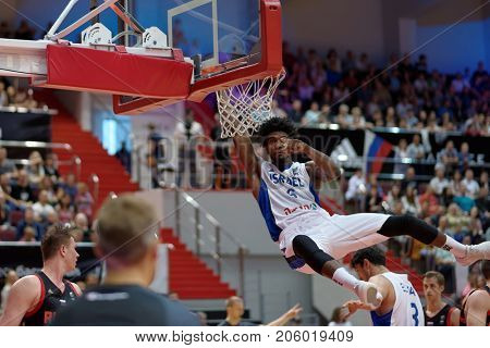 ST. PETERSBURG, RUSSIA - AUGUST 6, 2017: Shawn Dawson, Israel scores in the basketball match Russia (black) vs Israel (white) for Kondrashin-Belov Cup. Israel won 79-71