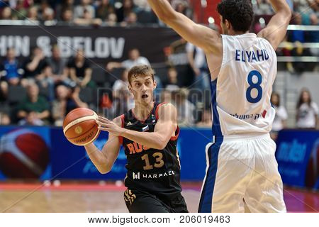 ST. PETERSBURG, RUSSIA - AUGUST 6, 2017: Dmitry Khvostov, Russia and Lior Eliyahu, Israel in action during basketball match Russia (black) vs Israel (white) for Kondrashin-Belov Cup. Israel won 79-71