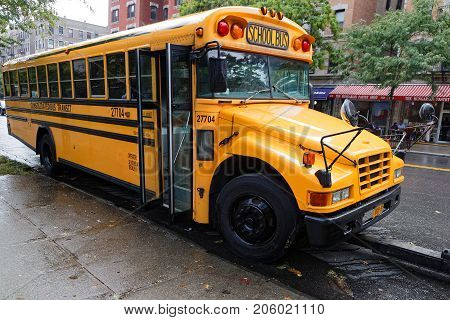 NEW YORK CITY USA September 13 2017 : School bus in Harlem. Harlem is a large neighborhood in the northern section of the New York City borough of Manhattan.
