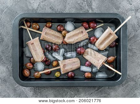 tray with ice and ice-cream from gooseberries, topview