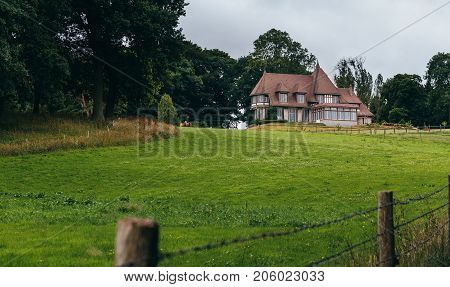 Country House With Green Garden And Lawn In The Region Of Normandy, France. Beautiful Countryside, F