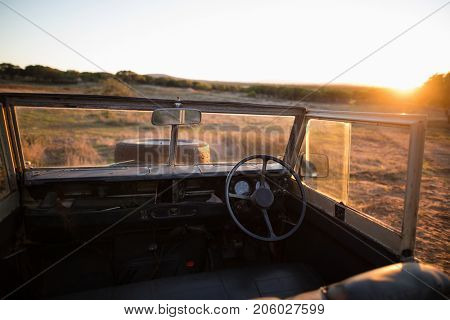 View of interior of car during sunset
