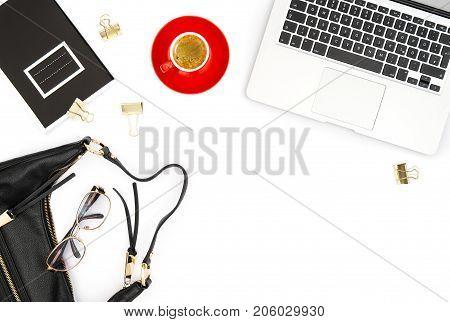 Feminine office desk. Laptop coffee on white background. Fashion flat lay for social media