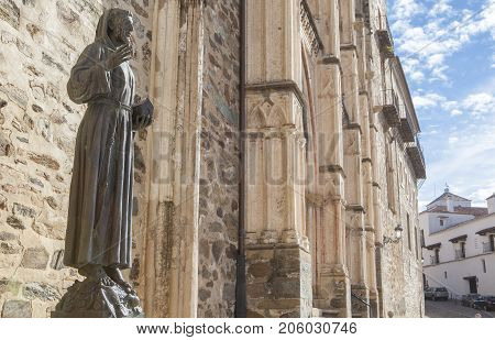 Guadalupe Spain - September 3th 2017: Francis of Assisi bronze statue at Guadalupe Monastery entry. Caceres Extremadura Spain