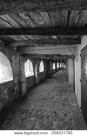 Brisighella (Ravenna Emilia Romagna Italy): the famous covered street known as via degli Asini or via del Borgo. Black and white