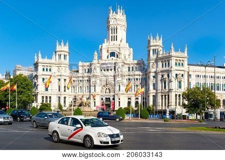 MADRID,SPAIN - AUGUST 5,2017 : Plaza de Cibeles and the Palace of Cibeles, a symbol of the city of Madrid