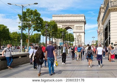PARIS,FRANCE - JULY 29,2017 : The Champs-Elysees and the Arc de Triomphe in central Paris on a sunny summer day