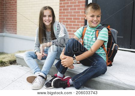 A Portrait of two school friends with backpacks