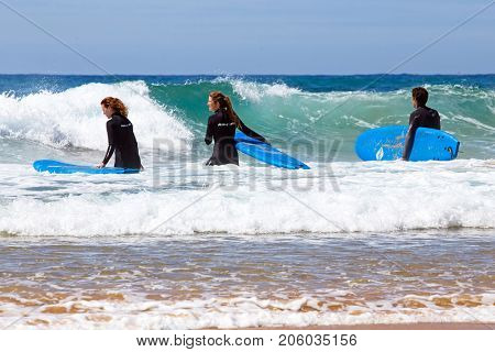 VALE FIGUEIRAS, PORTUGAL - 14th MAY 2017: Surfers getting surfers lessons at Vale Figueiras beach in Portugal on may 14 2017