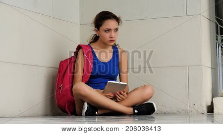 Confused Student Attractive Female With a Backpack