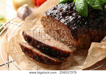 Tasty baked turkey meatloaf on cooling rack