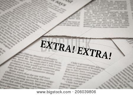 extra! extra! headline or issue on newspaper background