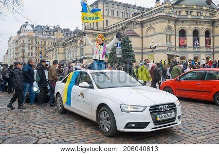 KIEV (KYIV) UKRAINE - DECEMBER 1 2013: Girl with a Ukrainian flag on the car