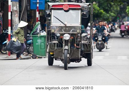 HANOI VIETNAM - AUGUST 2017: Street with lots of traffic in the Old quarter of Hanoi