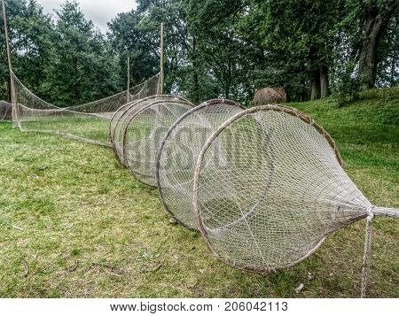 Old fishnets exhibited in heritage park in Kluki, near Slowinski National Park, Poland