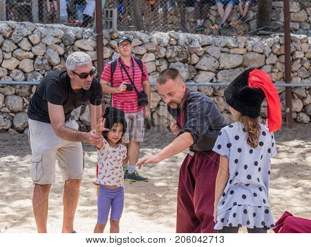 Jerusalem Israel September 23 2017 : Ukrainian Cossack shows children the secrets of martial arts at the festival